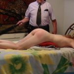 spanking_bent_over_bed_pillow